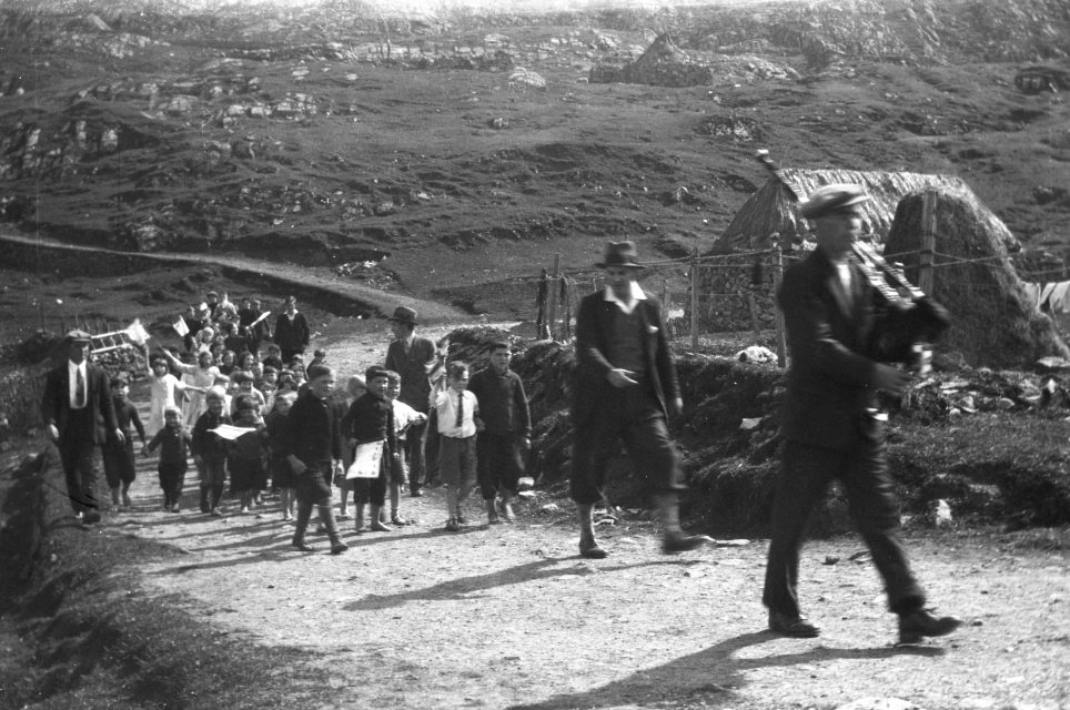 the piper leads a group of children